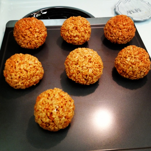 Orange balls of Rice Krispie by My Life as a Trophy Wife
